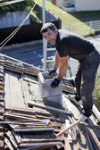 Roofer replacing shingles — Stock Photo