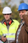 A concerned construction foreman — Stock Photo