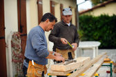 Two carpenters working on the same job — Stock Photo