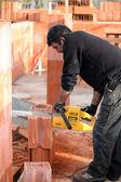 Mason sawing bricks — Stock Photo