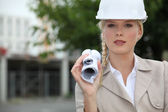 Young architect stood with role — Stock Photo