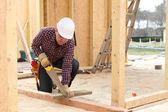 Man sawing wood — Stock Photo