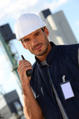 Portrait of foreman with talkie walkie in construction site — Stock Photo