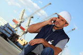 Foreman on the phone in construction site — Stock Photo