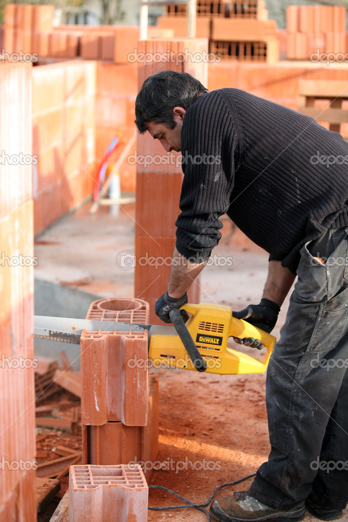Mason sawing bricks — Stock Photo #10520739