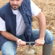 Stock Photo: Farmer opening water pipe