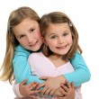 Royalty-Free Stock Photo: Two sisters hugging.