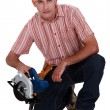 Stock Photo: Woodworker with circular saw