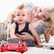 Stock Photo: Little boy with radio-controlled car