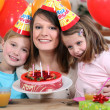 Woman celebrating a birthday with her kids — Stock Photo