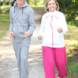 Elderly couple jogging — Stock Photo