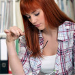 A young red-hair studying for exams. — Stock Photo #8010646