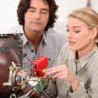 Couple fixing television - Stockfoto