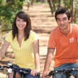 Stock Photo: Teenage couple on bike ride
