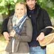 Couple with a basket — Stock Photo #8010780