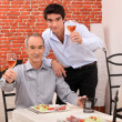 Stock Photo: Father and son having dinner together