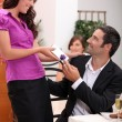 Woman giving a gift over dinner — Stock Photo