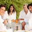 Friends having breakfast together outside — Stock Photo