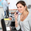 Female operator in a call center — Stock Photo