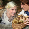 Couple enjoying a walk in the forest — Stock Photo #8012488