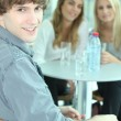 Teenagers with a glass of water — Stock Photo