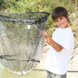 Boy with a huge fishing net - Stockfoto
