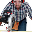 Royalty-Free Stock Photo: Man with goggles using band-saw