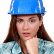A portrait of a female construction worker. — Stockfoto
