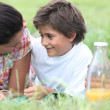 Stock Photo: Mother and son having summer picnic