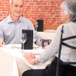 Old couple in restaurant — Stock Photo