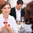 Women drinking wine in a restaurant — Stock Photo #8014666