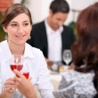 Women drinking wine in a restaurant — Stockfoto