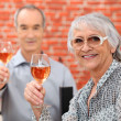 Senior couple celebrating anniversary in a restaurant — Stock Photo #8014671