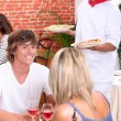 Stock Photo: Young couple eating out in pizzeria