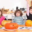 Stock Photo: Kids preparing pumpkins for Halloween
