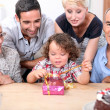Family celebrating a birthday together — Stock Photo #8015072