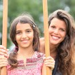 Stock Photo: Mother with a daughter on stilts