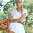 Blond woman collecting fruits — Stock Photo #8015624
