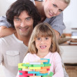 Parents spending time with their little girl at home — Stock Photo