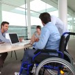 Employee in wheelchair — Stock Photo