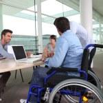 Employee in wheelchair — Stock Photo