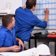 Stock Photo: Laborers in office planning appointments