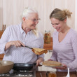 Mother and daughter cooking pancakes — Stock Photo #8016365