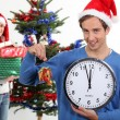 Young man and young woman waiting for Christmas — Stock Photo #8016575