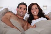 Husband and wife in bed together — Stock Photo