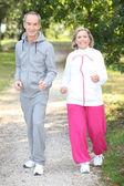 Elderly couple jogging — Stock Photo