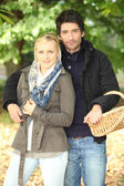 Couple with a basket — Stock Photo