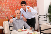 Father and son having dinner together — Stock Photo