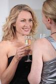 Women drinking champagne — Stock Photo