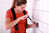 Female electrician working — Stock Photo